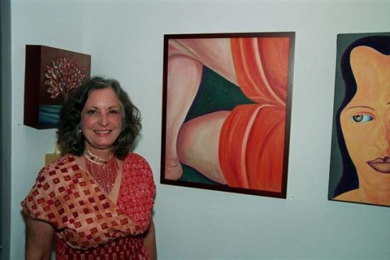 Exhibiting AMP Artist Ann Storc with her painting